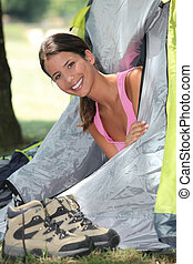 Woman holidaying in a tent