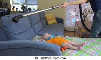 woman hoover sofa baby - Woman mother hands hoover dust from...