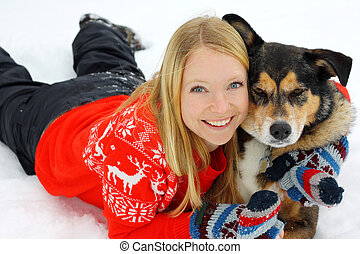 Woman Hugging German Shepherd Dog in Snow