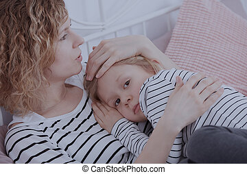 Woman hugging little girl