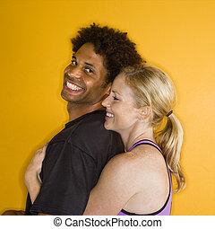 Woman hugging man.