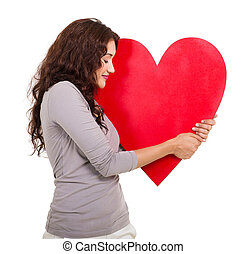 woman hugging red heart shape - happy woman with hugging a...