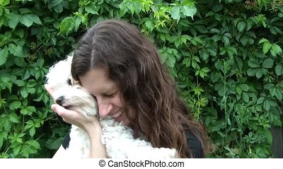 Woman Hugging Small Dog