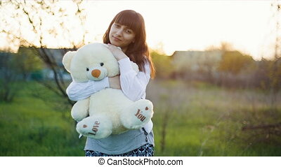 Woman hugs teddy bear - Happy woman with a teddy bear on...