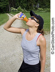 woman hydrating with juice
