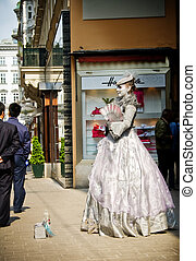 Woman impersonating queen Marie Antoinette near Hofburg palace, Vienna