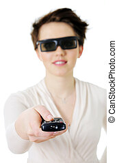 Woman in 3d glasses holding a television pilot