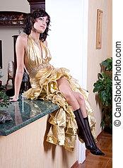 woman in a aureate dress