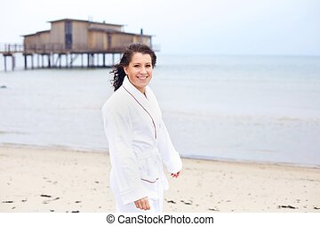 Woman in a Bathrobe Enjoying the Sunshine