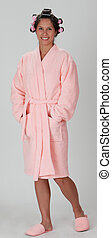Woman in a bathrobe - Young woman in a pink plush bathrobe...