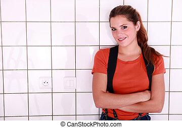Woman in a bathroom.