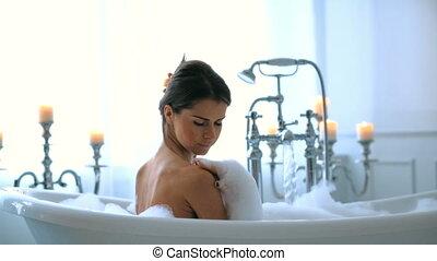 Woman in a bathtub - Hygiene. Beautiful girl in a bathtub