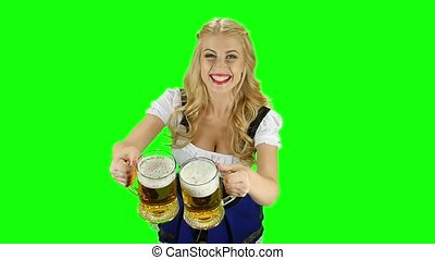 Woman in a bavarian costume offers glasses with beer. Green screen. Slow motion