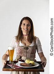 woman in a bavarian dirndl with a tray
