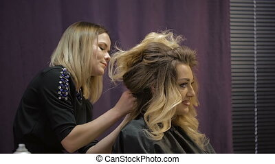 Woman in a beauty salon. blonde
