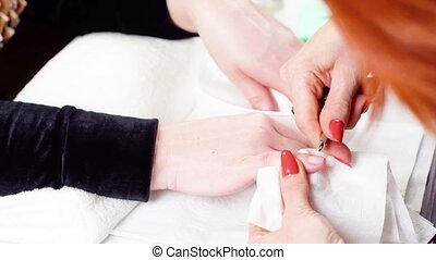 Woman in a Beauty Salon receiving a manicure - Woman in a...
