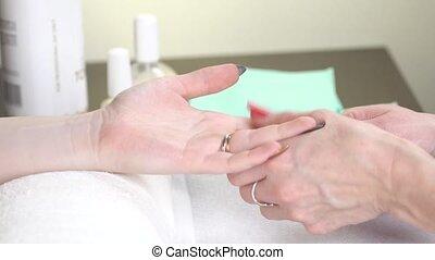 Woman in a Beauty Salon receiving a manicure - Woman in a...