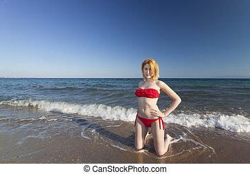 woman in a bikini on the beach