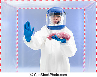 Woman in a biohazard suit with a meat sample