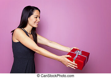 Woman in a black dress giving a present
