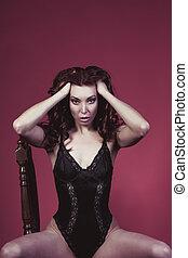 Woman in a black lace underwear