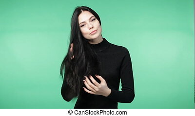 woman in a black shirt playing with the hair