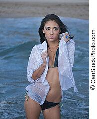 Woman in a blue bathing suit