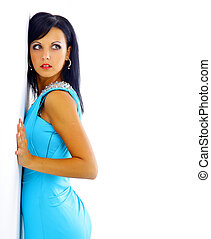 woman in a blue dress posing on a white background
