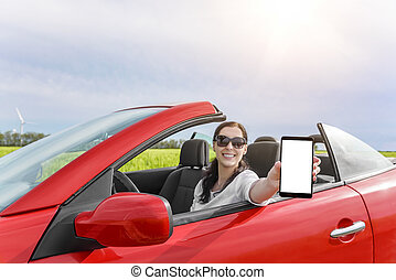 Woman in a car showing smartphone.