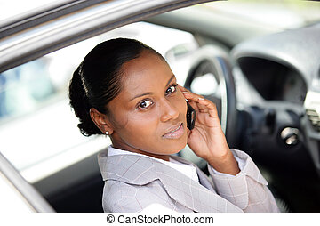 Woman in a car using a cellphone