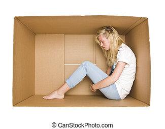 Woman in a cardboard box - Woman siting in a cardboard box...