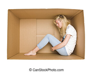 Woman in a cardboard box - Woman siting in a cardboard box...