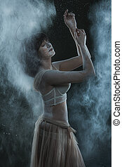 Woman in a cloud of flour.