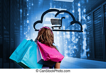 Woman in a data center holding shopping bags and looking at...