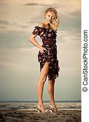 Woman in a dress.