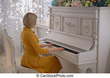 Woman in a dress at the piano