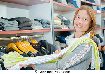 Woman in a garment shop