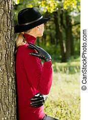 Woman in a hat and black gloves