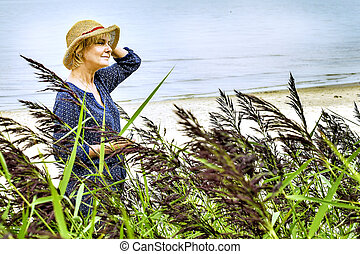 woman in a hat by the sea