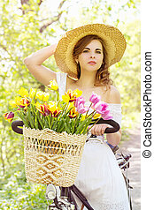 Woman in a hat on a bicycle