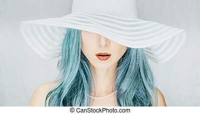 Woman in a hat with wide brim. - Young woman with blue hair...