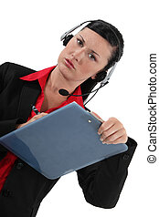 Woman in a headset with a clipboard
