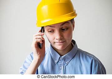woman in a helmet with a mobile phone