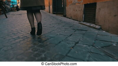 Woman in a hurry running along the street - Steadicam and...