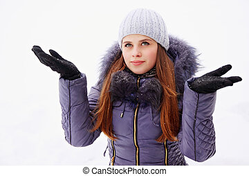 woman in a jacket catches the snow