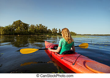Woman in a kayak on a river