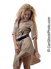 Woman in a khaki dress - attractive blond wearing a khaki...