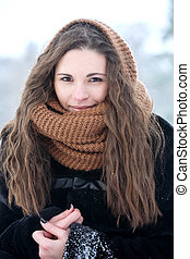 Woman in a knitted scarf