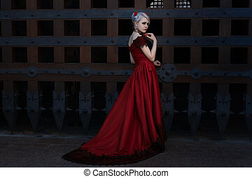 Woman in a long red dress.