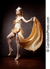 Woman in a luxurious style with flying fabric - The image of...